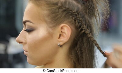 Hairdresser pigtail braids young girl - a hairdresser...