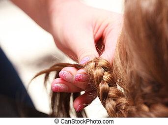 Hairdresser plaiting hair little girl child in hairdressing ...