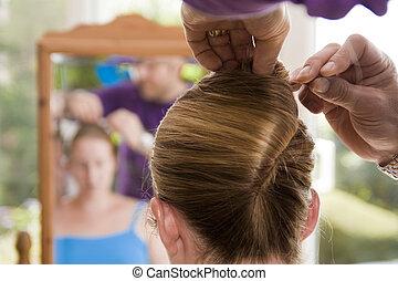 Hairdresser preparing bride for wed - Back shot of ...