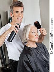 Hairdresser Setting Up Customer's Hair