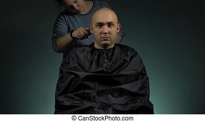 Hairdresser shaving a brunette man - Footage of shaving...