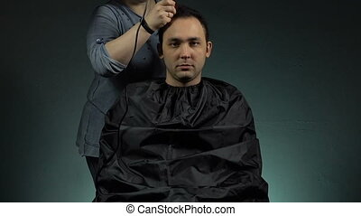 Hairdresser shaving man - Footage of shaving man's head on...