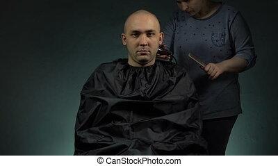 Hairdresser shaving soldier - Footage of shaving man's head...