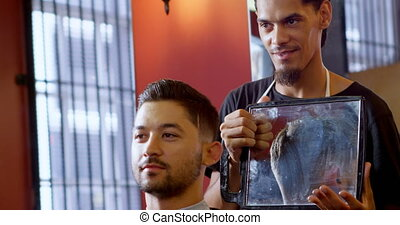 Hairdresser showing customer haircut in mirror 4k -...