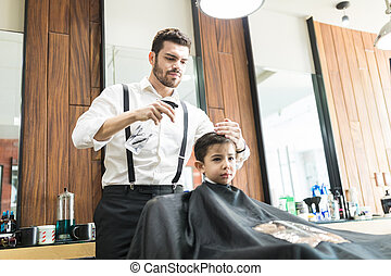 Hairdresser Sprinkles Water On Customer's Hair In Barber Shop