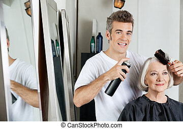 Hairdresser Styling Client's Hair At Salon