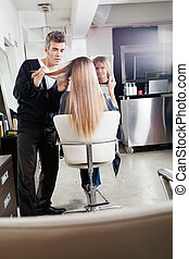 Hairdresser Styling Client's Hair