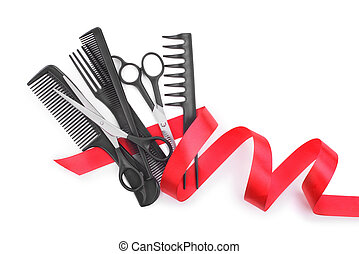 hairdresser tools with gift ribbon isolated on white