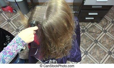 Hairdresser using dryer on woman wet hair. 4K - Hairdresser...