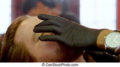 Hairdresser using edge razor in hair salon 4k - Close-up of ...