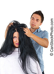 Hairdresser with customer woman with long hair