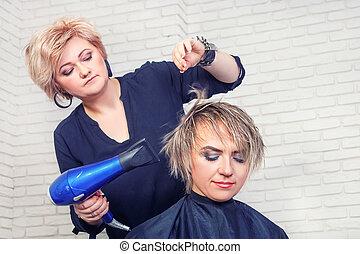 Hairdresser with hair dryer