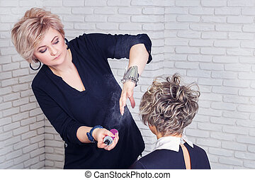 Hairdresser with hair spray