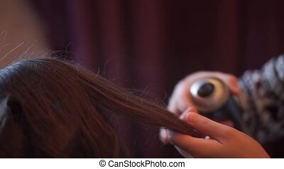 Hairdresser with hairspray - Hairdresser using with...