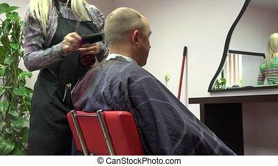 hairdresser woman cut male client in beauty salon barber. 4K