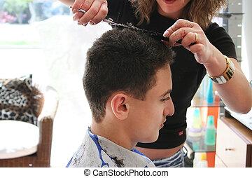 Hairdresser work - Hairdresser cutting teens hair in beauty...