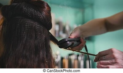 Hairdresser working with client in the beauty salon, shaping...