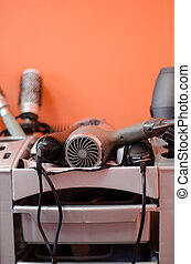 hairdressing accessories lies in the gray shelf -...