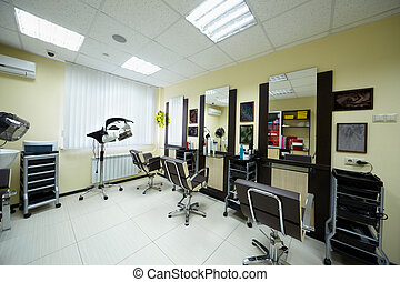 Hairdressing cabinet in the beauty salon, noncopyright abstractions in the frames on the wall