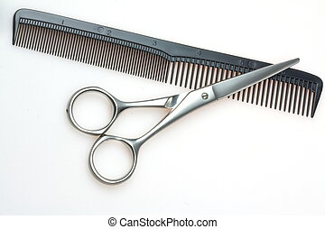 hairdressing scissors and comb isolated on a white background