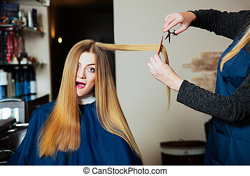 Hairdressing with scissors and comb.