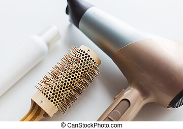 hairdryer, brush and hot styling hair spray - hair tools, ...