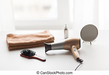 hairdryer, hair brushes, mirror and towel - hair tools, ...
