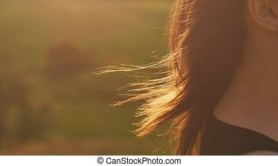 haired girl in the sun slow motion video - clear day the...