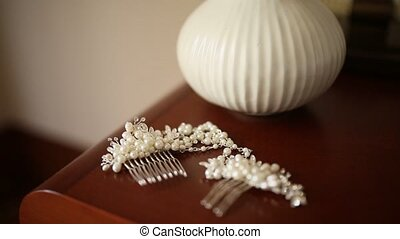 Hairpin for hair with pearls. On the table with dry lavender...