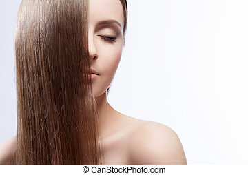 Hairstyle - Attractive girl with hair on white background