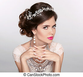 Hairstyle. Attractive girl with makeup. Jewelry Earring....