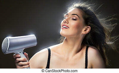 hairstyle - Beautiful girl doing her hair
