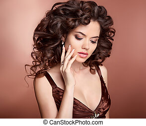 Hairstyle. Beautiful girl with long curly hair