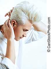 hairstyle - Beautiful young man with sensual look posing at...