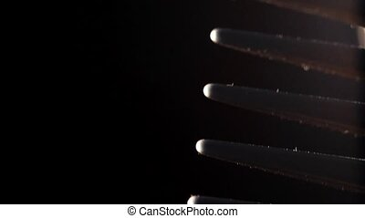 comb on a black background
