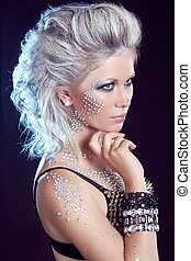 Hairstyle. Fashion Beauty Girl. Punk Style Woman with strasses on face, on a dark background