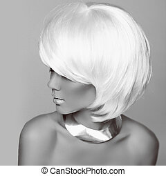 Hairstyle. Fashion blonde woman. White Short Hair. Beautiful girl model.  Black and White Photo. Fringe. Jewelry. Vogue Style.