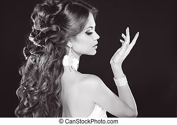 Hairstyle. Glamour Fashion Woman Portrait Of Beautiful brunette. Black and white photo.