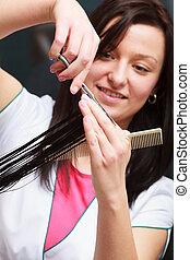 Hairstylist cutting hair client