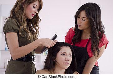 Hairstylist during training - Cute female hairstylist...