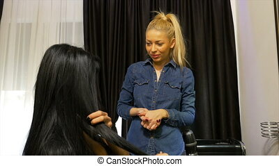 Hairstylist talks with her customer in hair salon