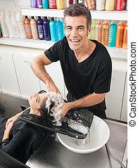 Hairstylist Washing Customer's Hair