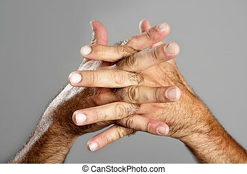 Hairy man hand closeup expression over gray