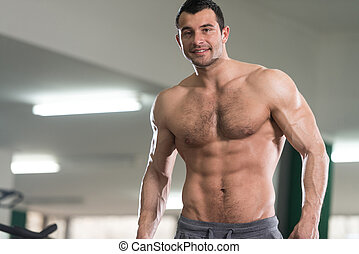 Hairy Man Showing Abdominal Muscle