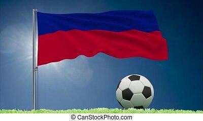 Haiti flag fluttering and football rolls