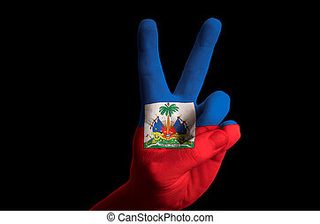 haiti national flag two finger up gesture for victory and winner