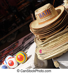 Haiti Souvenirs - Haitian straw hats and maracas for sale in...