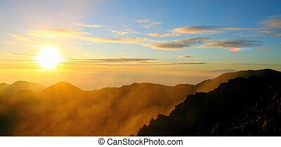 haleakala sunrise - misty sunrise with rainbow fragment from...