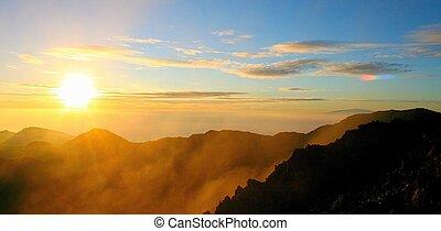 haleakala sunrise - misty sunrise with rainbow fragment from...