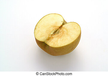 Half a green apple turning brown